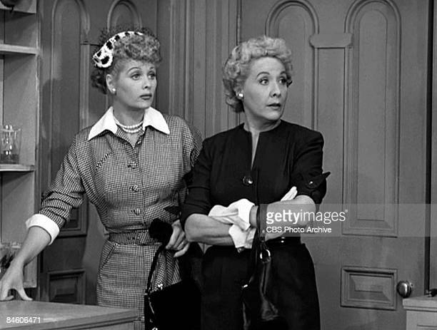 American comic actresses Lucille Ball as Lucy Ricardo and Vivian Vance as Ethel Mertz stand side by side in a scene from an episode of the television...