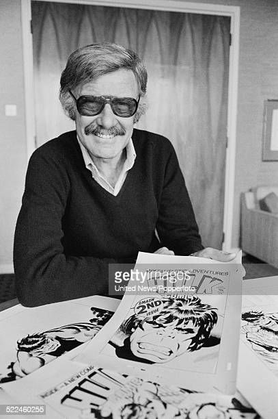American comic book writer and editor Stan Lee pictured with Hulk comic artwork in London on 26th February 1979