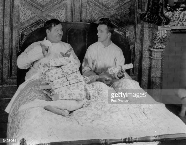 American comic duo Oliver Hardy and Stan Laurel exchanging gifts