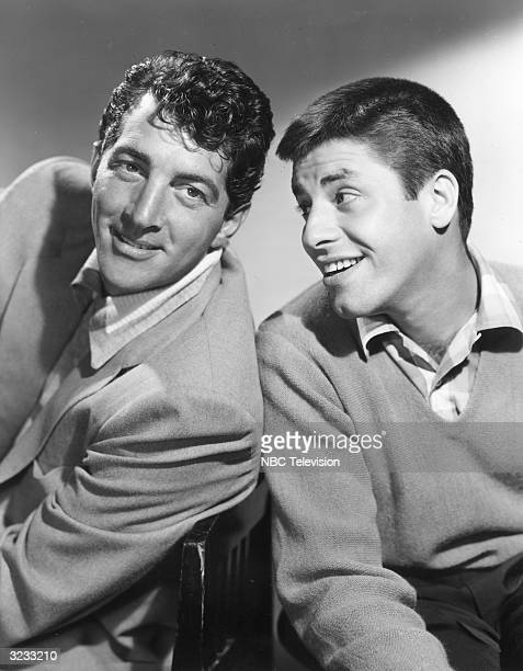 American comic team Dean Martin and Jerry Lewis smiling in a promotional portrait for the television show 'The Colgate Comedy Hour' of which they...