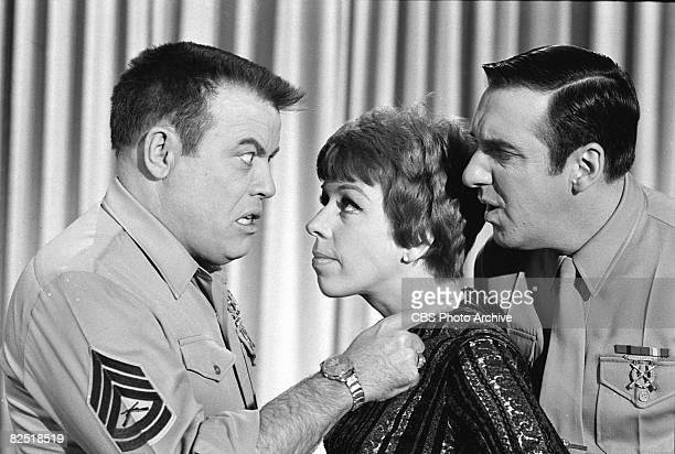 American commedienne and actress Carol Burnett stands between actors Frank Sutton and Jim Nabors in a scene from an episode of the television comedy...