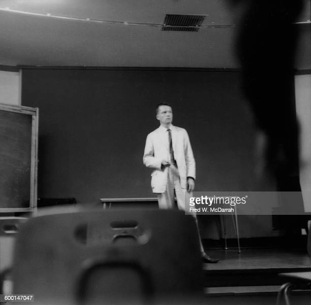 American composer and artist George Brecht stands in a classroom at the New School New York New York August 5 1959 At the time Brecht was a student...