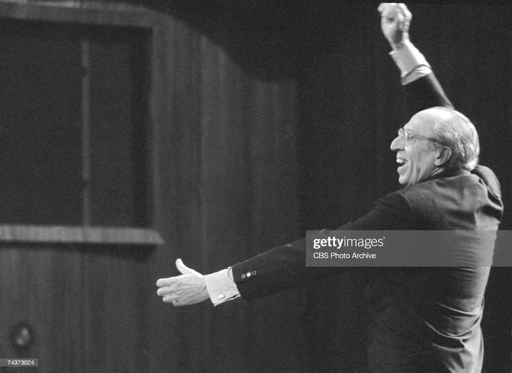 American composer and conductor <a gi-track='captionPersonalityLinkClicked' href=/galleries/search?phrase=Aaron+Copland&family=editorial&specificpeople=571902 ng-click='$event.stopPropagation()'>Aaron Copland</a> (1900 - 1990) smiles as he conducts during the filming of one of his televised 'Young People's Concerts' featuring the New York Philharmonic Orchestra, New York, New York, November 1, 1969.