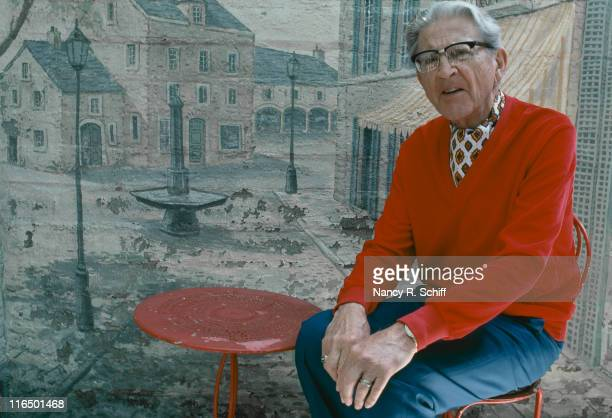 American composer and lyricist Meredith Willson wearing a red vneck jumper and cravat 1982