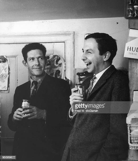 American composer John Cage and Pop artist Robert Rauschenberg share a laugh at a party in Greenwich Village New York New York April 26 1959