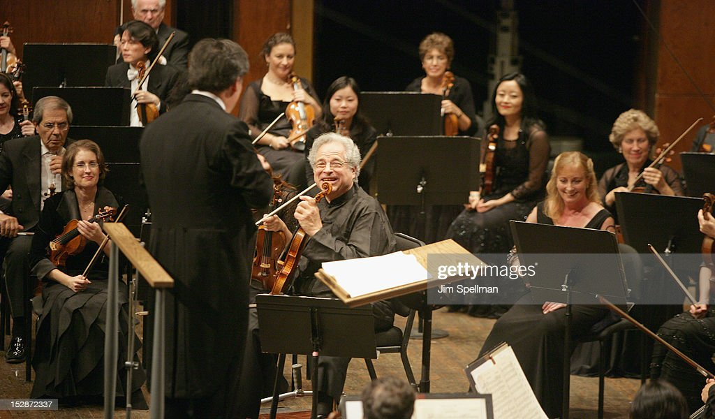 American conductor and violinist Alan Gilbert and violinist <a gi-track='captionPersonalityLinkClicked' href=/galleries/search?phrase=Itzhak+Perlman&family=editorial&specificpeople=593397 ng-click='$event.stopPropagation()'>Itzhak Perlman</a> attend the New York Philharmonic 171st Season Opening Night Gala at Avery Fisher Hall at Lincoln Center for the Performing Arts on September 27, 2012 in New York City.