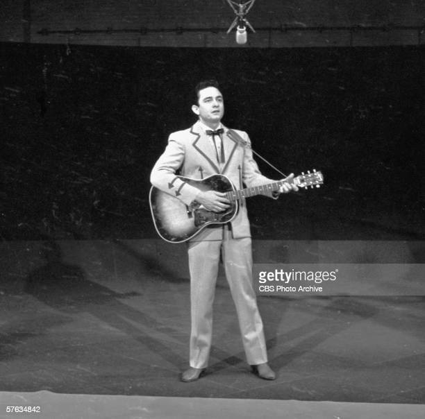 American country and western singer Johnny Cash plays guitar and sings on 'The Ed Sullivan Show' New York New York February 8 1959