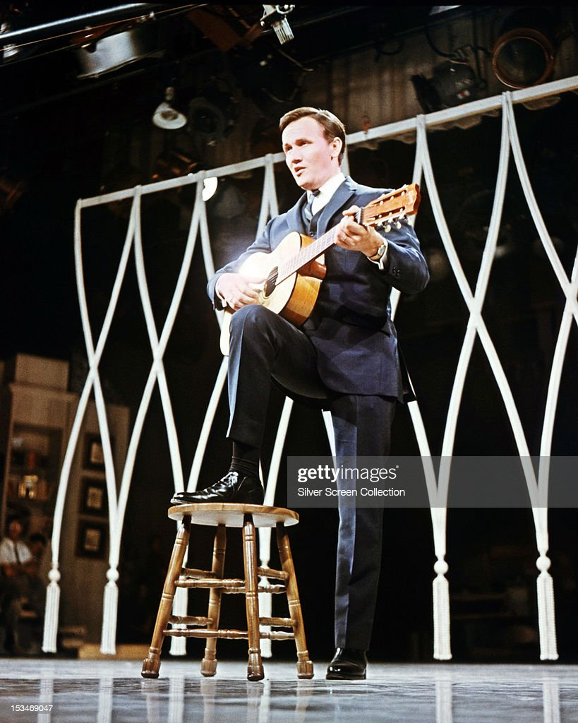 American country and western singersongwriter Roger Miller performing with an acoustic guitar circa 1966