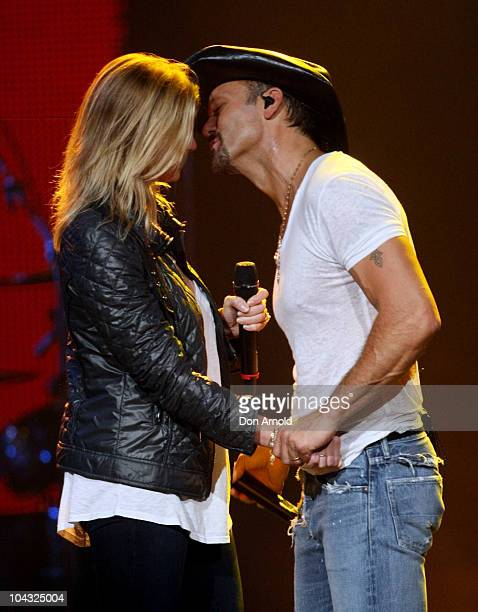 American country music singer Tim McGraw suprises his wife Faith Hill on stage on the night of her birthday during McGraw's first ever tour of...