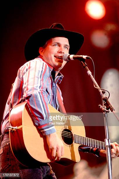 American country musician Garth Brooks peforms on stage during Farm Aid at the RCA Dome Indianapolis Indiana April 7 1990