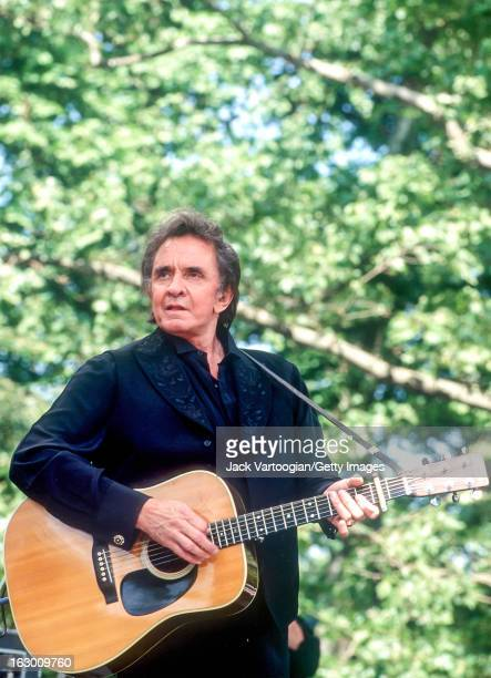 American country musician Johnny Cash performs with the Highwaymen at Central Park SummerStage New York New York May 23 1993