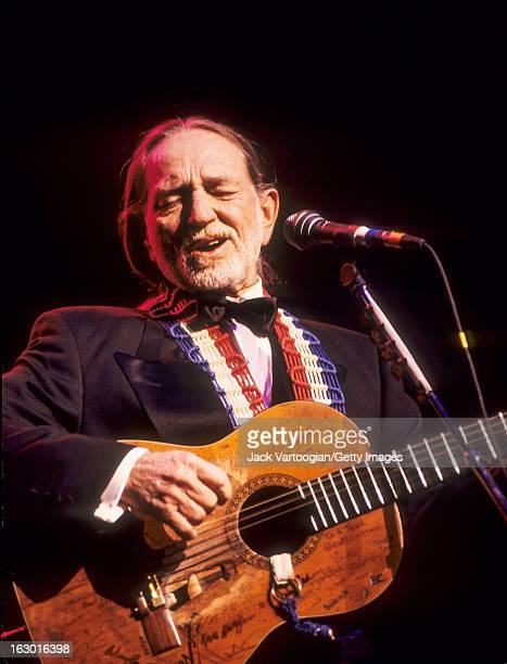 American country musician Willie Nelson in formal attire performs during a Valentine's Day concert at the Beacon Theater New York New York February...