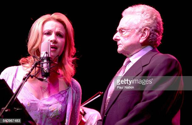 American country musicians Patty Loveless and Ralph Stanley perform together onstage Chicago Illinois July 22 2002
