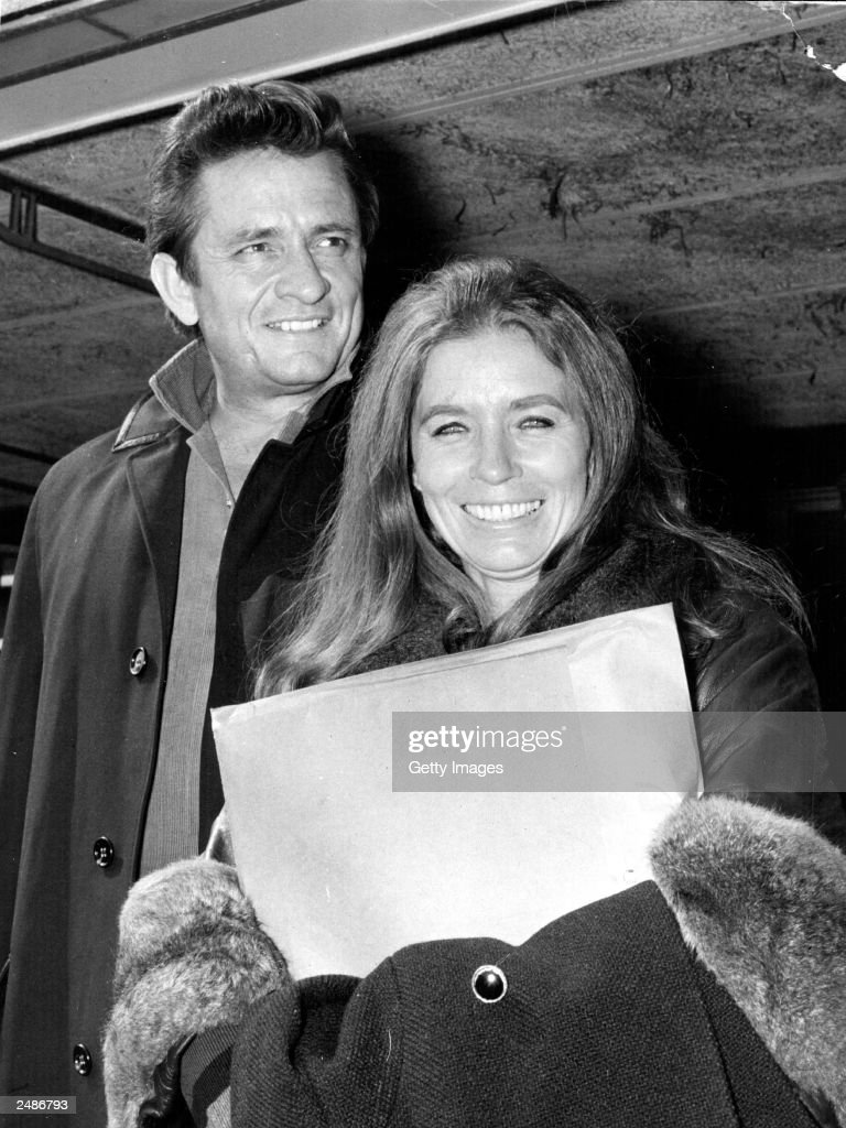 American country singer and songwriter Johnny Cash (L) and his wife June Carter Cash of the Carter Family group arrive May 1, 1968 at London Airport in London, United Kingdom. Johnny Cash died September 12, 2003 in a hospital in Nashville, Tennessee while being treated for a stomach complaint. He was 71.