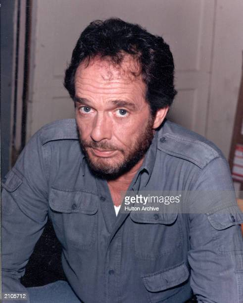 American country singer and songwriter Merle Haggard poses wearing a blue shirt circa 1985