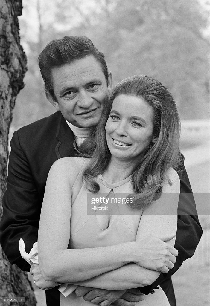 American Country Singer Johnny Cash With His Wife June Carter Photographed In A London Park During