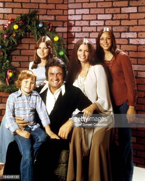 American country singersongwriter Johnny Cash with his wife June Carter Cash and three of their children circa 1976 Left to right John Carter Cash...