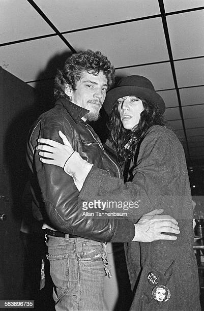 American couple photographer and artist Robert Mapplethorpe and musician and poet Patti Smith as they pose backstage at Max's Kansas City New York...