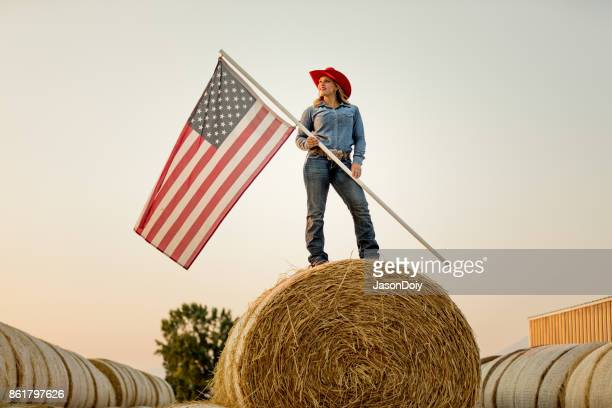 American Cowgirl Horseback with American Flag