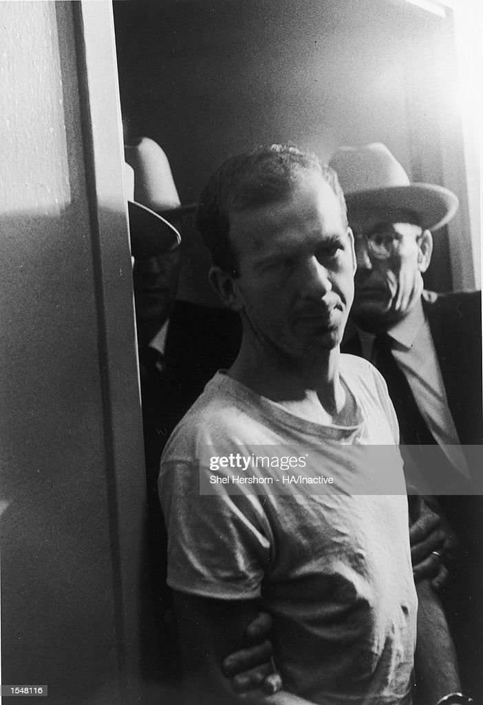 American criminal Lee Harvey Oswald (1939 - 1963) is escorted in handcuffs by Dallas police for questioning following the assassination of president John F. Kennedy, November 22, 1963.