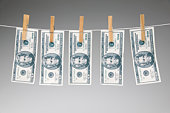 American currency on clothesline