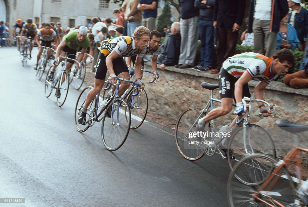 American cyclist <a gi-track='captionPersonalityLinkClicked' href=/galleries/search?phrase=Greg+LeMond&family=editorial&specificpeople=504953 ng-click='$event.stopPropagation()'>Greg LeMond</a> (centre, in white, yellow and black Renault-Elf-Gitane colours) competing in the Critérium de Château-Chinon road race, Château-Chinon, Nièvre, France, circa 1982.