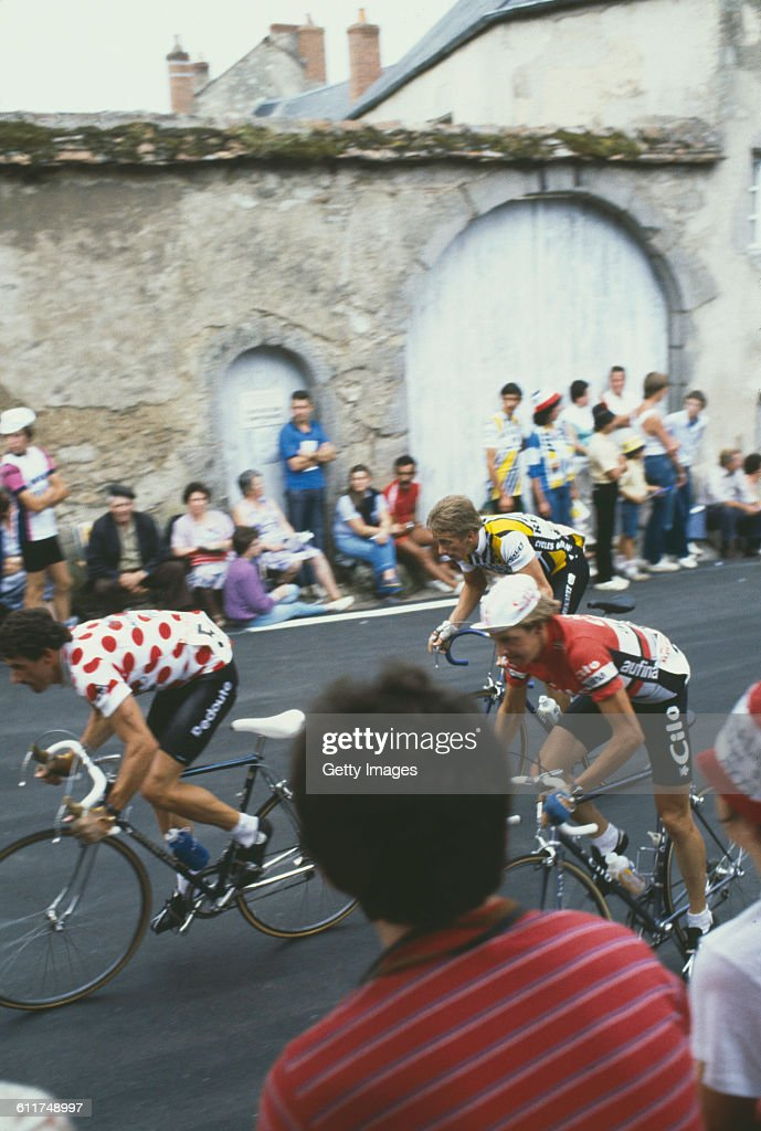 American cyclist <a gi-track='captionPersonalityLinkClicked' href=/galleries/search?phrase=Greg+LeMond&family=editorial&specificpeople=504953 ng-click='$event.stopPropagation()'>Greg LeMond</a> (background, right) competing in the Critérium de Château-Chinon road race, Château-Chinon, Nièvre, France, circa 1982.