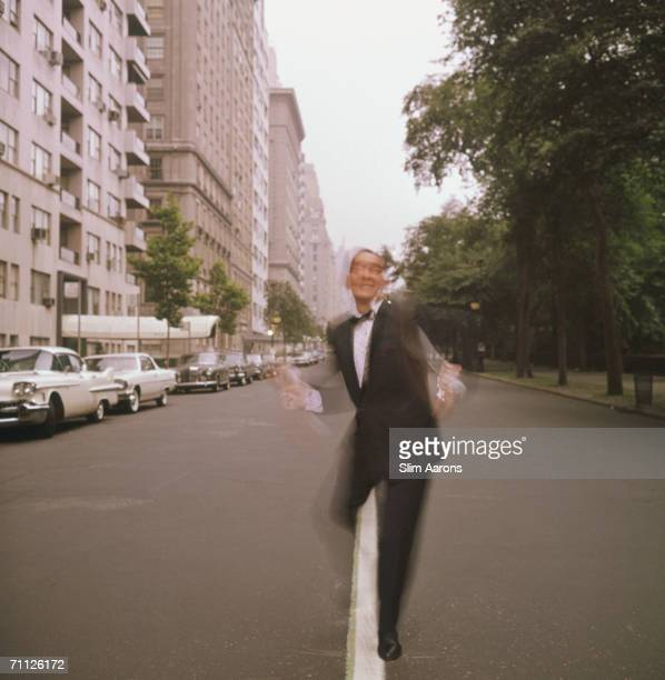 American dance instructor 'Killer' Joe Piro dances past the park in New York July 1964