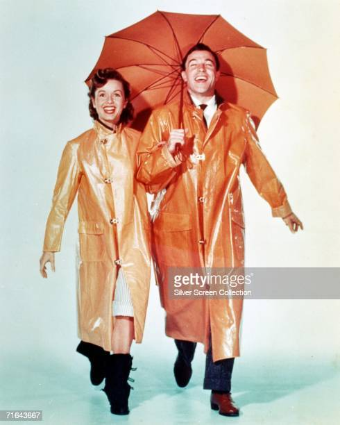 American dancer and actor Gene Kelly as Don Lockwood and Debbie Reynolds as Kathy Seldon in 'Singin' in the Rain' directed by Stanley Donen and Kelly...