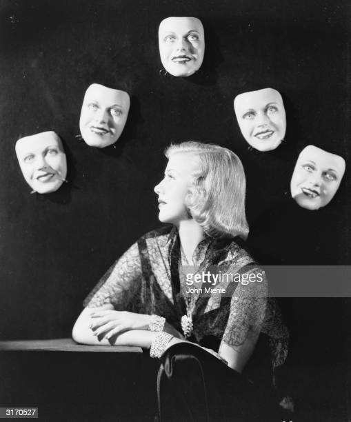 American dancer and actress Ginger Rogers in costume for her role in 'Shall We Dance' surrounded by a cluster of floating disembodied heads