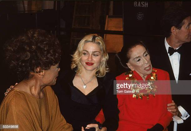 American dancer and choreographer Martha Graham attends a party with fellow celebrities singer Eartha Kitt performer Madonna and clothing designer...