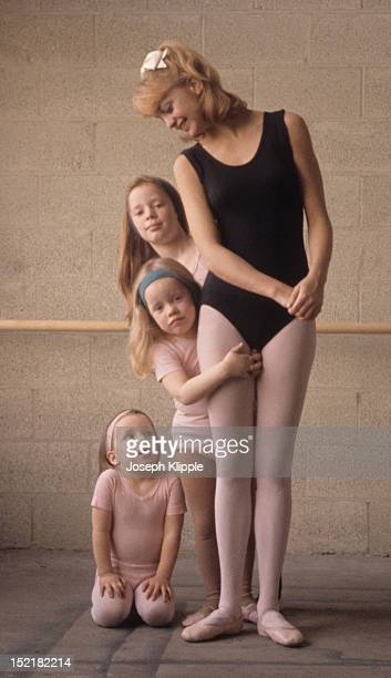American dancer and dance instructor and future actress Goldie Hawn poses with three of her young ballet students Washington DC 1964