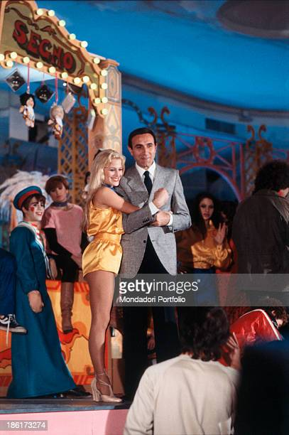American dancer and showgirl Heather Parisi hugging Italian TV presenter Pippo Baudo during the TV show Luna Park Italy 1979
