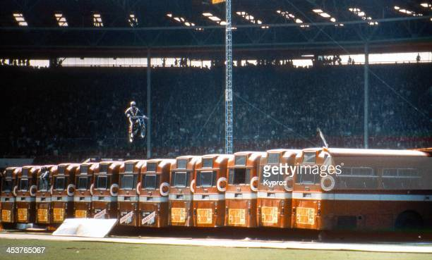 American daredevil Evel Knievel makes a motorcycle jump over thirteen AEC Merlin buses at Wembley Stadium in London 26th May 1975 The stunt ended in...
