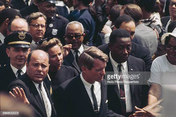 American Democratic Party politician and Senator from New York Robert F Kennedy attends the funeral procession of assasinated American minister and...