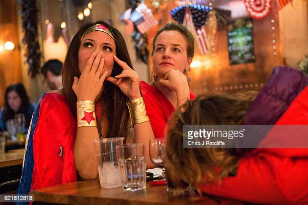 American Democratic Party supporters one in a Wonder Woman costume react to the news that Donald Trump has won the state of Florida at the Democrats...