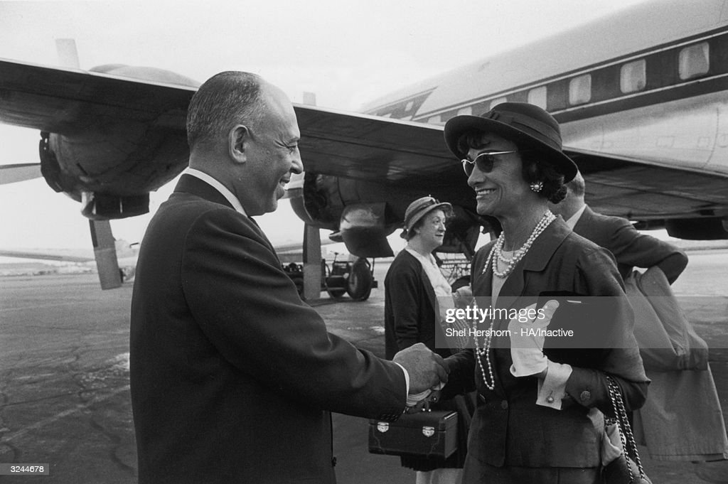 American department store executive Stanley Marcus holds hands and says goodbye to French fashion designer Coco Chanel at the airport, after her visit to the newest Neiman-Marcus store in Dallas, Texas.