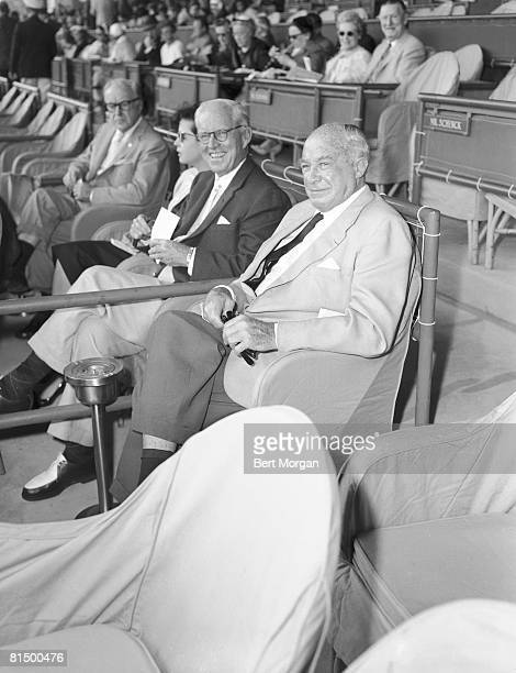 American diplomat and financier Joseph P Kennedy Sr and retail mogul Bernard F Gimbel sit together in the stands at the Hialeah Park Race Track...