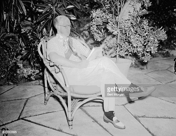 American diplomat and financier Joseph P Kennedy Sr reads a book on his patio in Palm Beach Florida January 29 1939