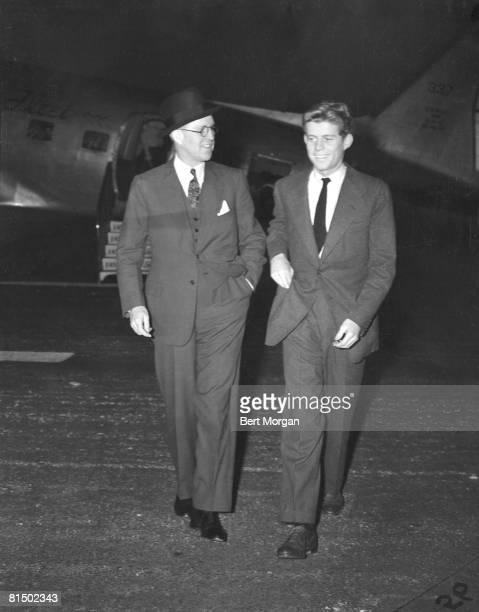 American diplomat and financier Joseph P Kennedy Sr walks with his son future US President John F Kennedy in Palm Beach Florida December December 28...