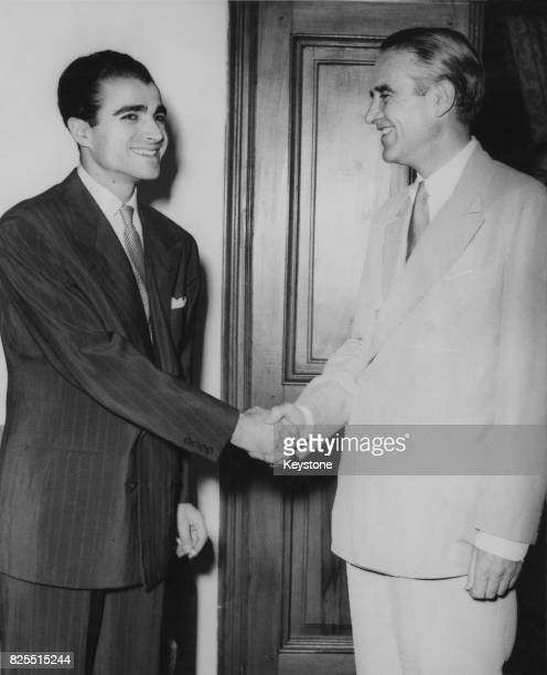 American diplomat W Averell Harriman advisor to President Truman shakes hands with Prince Abdul Reza Pahlavi of Iran during a visit to Tehran 25th...