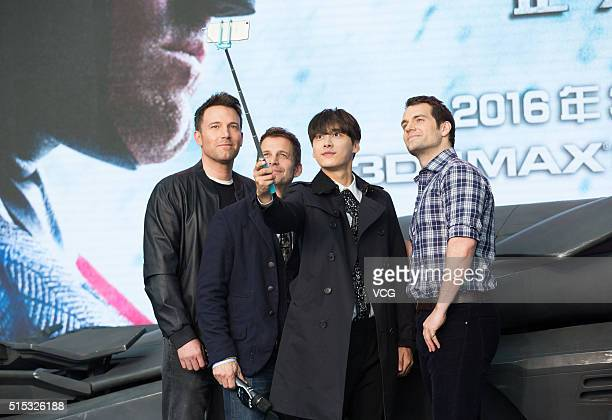 American director and actor Ben Affleck American filmmaker Zack Snyder Chinese actor Li Yifeng and British actor Henry Cavill attend the premiere of...