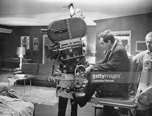 American director and screenwriter Stanley Kubrick on a camera dolly on the set of his film 'Dr Strangelove or How I Learned to Stop Worrying and...
