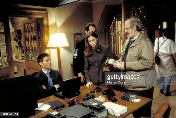 American director Brian De Palma with actors Tom Cruise and Emmanuelle Beart on the set of the film 'Mission Impossible' 1996