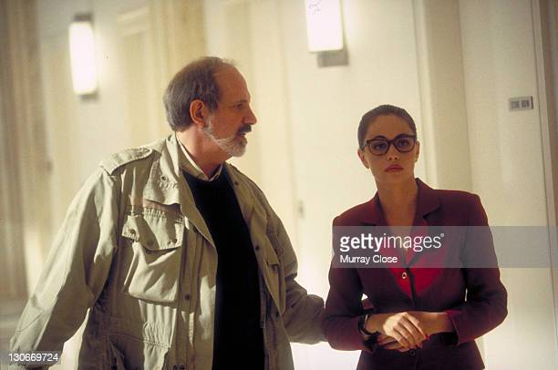 American director Brian De Palma with French actress Emmanuelle Beart on the set of the film 'Mission Impossible' 1996