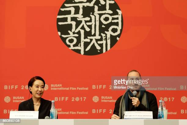 American director Darren Aronofsky and Kang Sooyoun the festival's executive director attend the official press conference for 'mother' during the...
