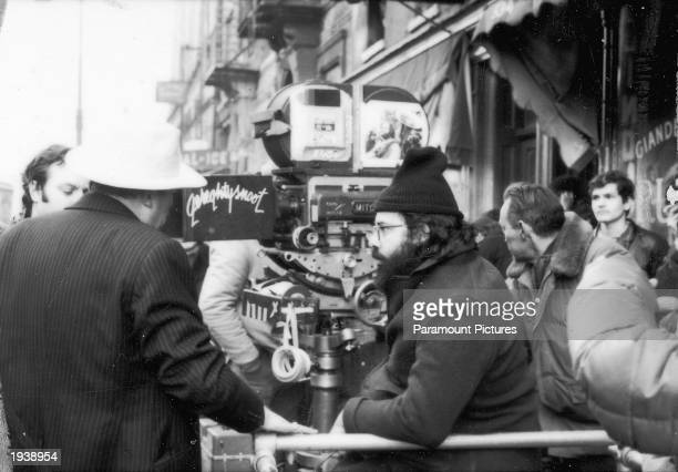 American director Francis Ford Coppola sitting with the camera on the set of his film 'The Godfather Part II' 1974