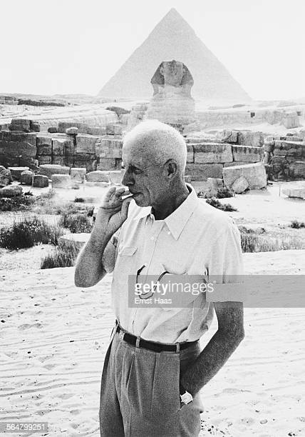 American director Howard Hawks on the set of his film 'Land of the Pharaohs' on location at the Giza Plateau in Egypt 1955 Behind him is the Great...