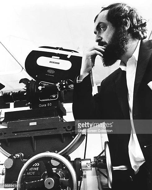 American director Stanley Kubrick standing next to a movie camera possibly on the set of 'Barry Lyndon' circa 1975