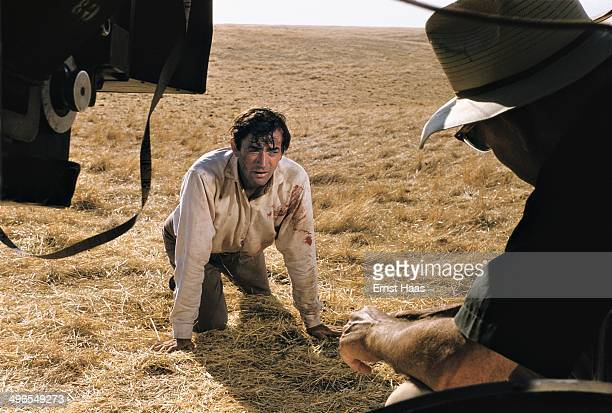 American director William Wyler directs actor Gregory Peck on the set of the western 'The Big Country' USA 1958